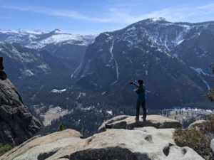 Jeney on top of Yosemite Falls taking a picture