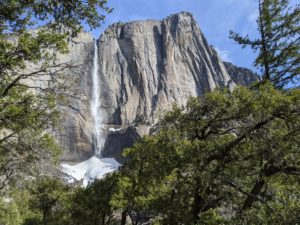 Yosemite Falls in March with snow at bottom